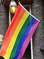Lesbian, Gay, Bisexual, Trans* & Queer Flag partially covering entrance.jpg