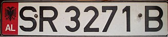 Vehicle registration plates of Albania - Plate with DIN 1451 font issued from 1995 to 2002. 'SR' stands for Sarandë District. Note the inclusion of the national identification strip on the left