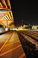 Lillestrøm train station platform at night.jpg