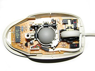Computer mouse - Mechanical mouse, shown with the top cover removed. The scroll wheel is gray, to the right of the ball.
