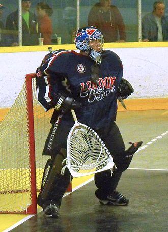 Goaltender (box lacrosse) - London Blue Devils Jr. B goalie wearing hockey-style helmet (2014).