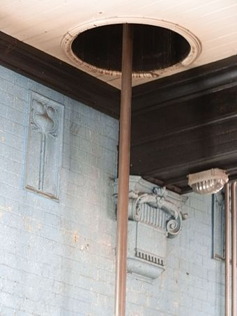 Fireman's pole in the fire engine room. London Road Fire Station - Interior - Pole.jpg