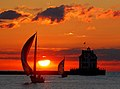 Lorain lighthouse with boats at sunset.jpg