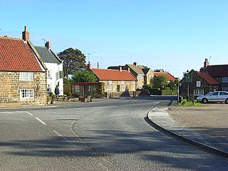 village and large civil parish, in the Scarborough district of North Yorkshire, England