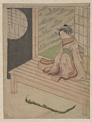 A Young Woman Seated upon the Engawa of a House