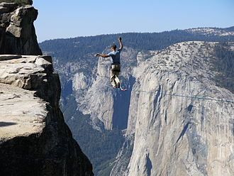 Slacklining - Man highlining at Taft Point in Yosemite National Park with El Capitan in the background.