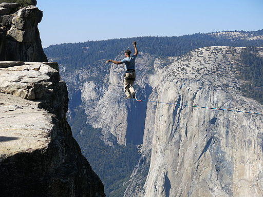 Man highlining in Yosemite National Park with El Capitan in the background