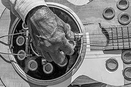 Man playing an acoustic brazilian guitar (Violão) on Marco Zero Square, Refice, Pernambuco, Brazil.jpg