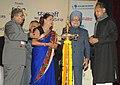 Manmohan Singh lighting the lamp to inaugurate the tenth Pravasi Bharatiya divas 2012, at Jaipur, in Rajasthan. The Prime Minister of the Republic of Trinidad and Tobago, Mrs. Kamla Persad-Bissessar.jpg