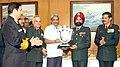 Manohar Parrikar presenting the Raksha Mantri's Trophy for the Best Service Hospital to the Commandant, Command Hospital (Eastern Command), Kolkata, Major General T.S. Ahluwalia, in New Delhi.jpg
