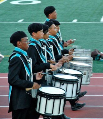 Snare drum - A line of marching snare drums in a high school marching band