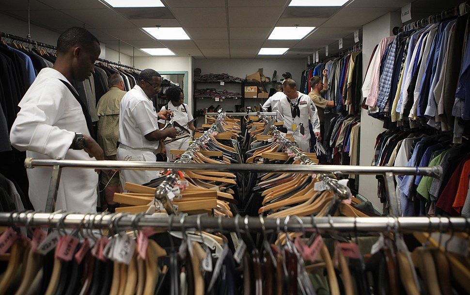 Marines and Sailors sort and organize hundreds of clothing items at the New England Center for Homeless Veterans