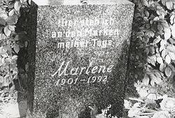 "Dietrich's gravestone in Berlin. The inscription reads ""Hier steh ich an den Marken meiner Tage"", (And reaching now the limit of my life), a paraphrased line from the sonnet Abschied vom Leben (Farewell from Life) by Theodor Körner."