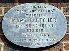 "Plaque reads: ""On this site stood ""The Cedars,"" wherein Mary Fletcher, née Bosanquet, resided 1763 – 1768. Erected by L.U.D.R.A. 1909."""