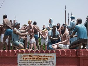 History of Sikhism - Sculpture at Mehdiana Sahib of the execution of Banda Singh Bahadur in 1716