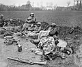 Men of the 51st Division resting in a hastily dug trench during the German spring offensiove, 10 April 1918. Q7854.jpg