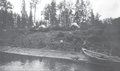 Men tracking a York boat, an inland boat used by the Hudson's Bay Company, along the Athabasca River.png