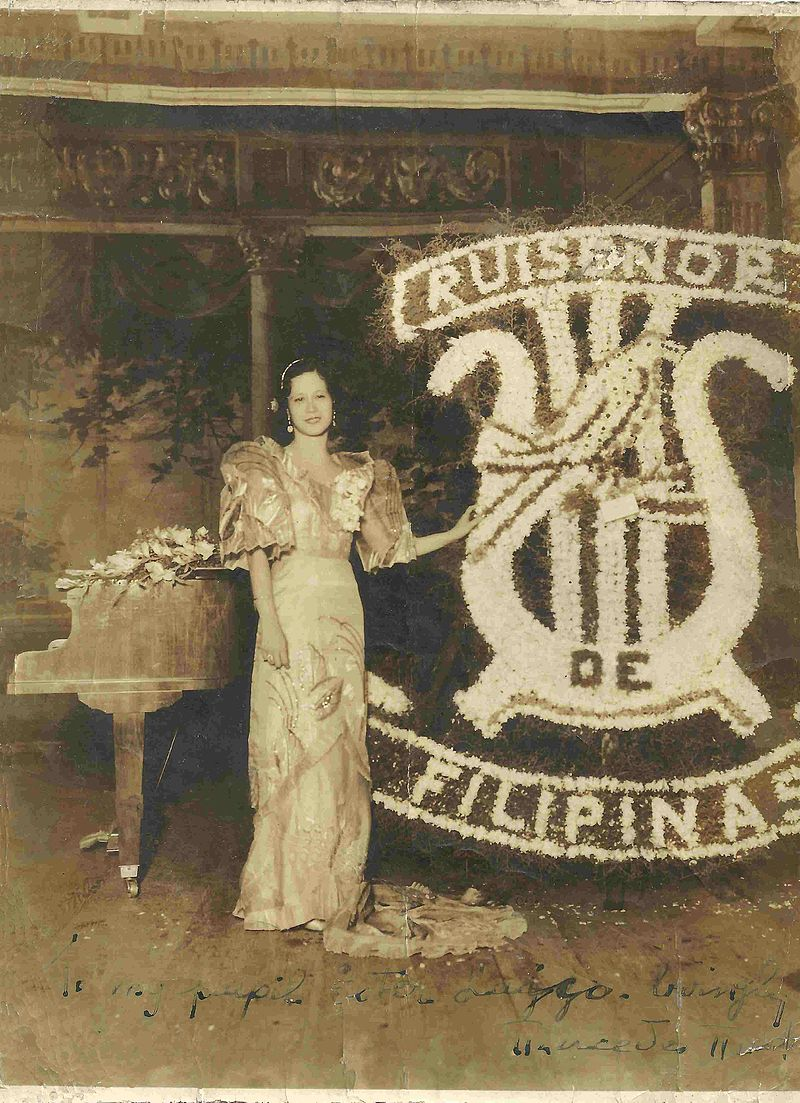 Ruiseñor de Filipinas (Nightingale of the Philippines).  Mercedes Matias-Santiago with a bouquet given to her by Philippine Commonwealth President Manuel Quezon following a performance, c1936.  Photo courtesy of Milagros Cayamanda-Morgan, Ottawa, Canada.