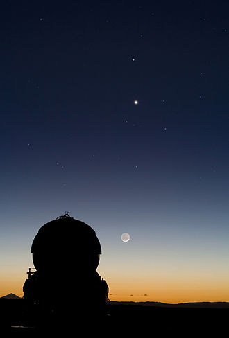 Conjunction (astronomy) - A conjunction of Mercury and Venus appears above the Moon, as viewed from the Paranal Observatory in northern Chile.