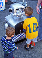 Metro-Man, the railroad's mascot, meets young visitors at Open House.