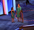 Michelle Obama and daughters at 2008 DNC (2893907573) (cropped1).png