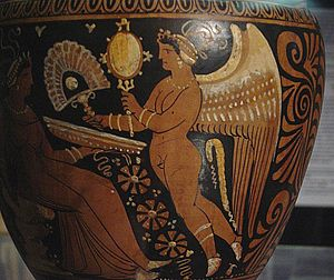 Hand fan - Eros offering a fan and a mirror to a lady. Ancient Greek amphora from Apulia, Archaeological Museum in Milan, Italy