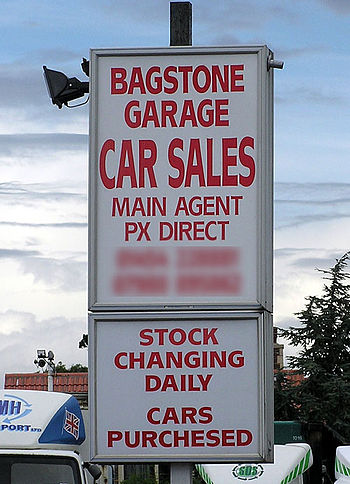 English: Misspelt sign at a garage at Bagstone...