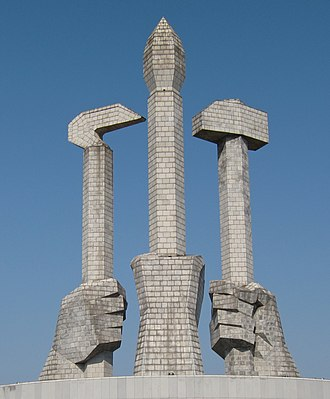 Monument to Party Founding - The element based on the emblem of the Workers' Party symbolizes the worker, farmer and intellectual.