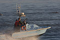 Morro Bay Harbor Patrol runs out to escort fishing boat Rita G., owned by Michelle, over the harbor's dangerous bar at harbor entry..jpg