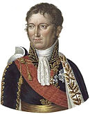 Color portrait depicts a clean-shaven man with a small mouth. He wears early 1800s court costume, a high-collared dark blue coat with gold braid, a red sash, and a white frill at the throat.
