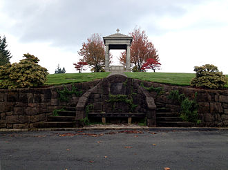 "Mount Calvary Cemetery (Portland, Oregon) - The hilltop altar is located on the north side of the Cemetery and bears the Latin inscription ""In Sacerdotum Memoriam"""