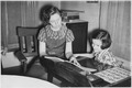 "NYA-Idaho-""sunshine and knowledge to the less fortunate through NYA""-young woman tutoring younger girl - NARA - 197140.tif"