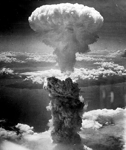 The Fat Man mushroom cloud resulting from the nuclear explosion over Nagasaki rises into the air from the hypocenter. Nagasakibomb.jpg