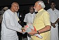 Narendra Modi being seen off by the Governor of Tamil Nadu, Dr. K. Rosaiah, on his departure from Coimbatore, Tamil Nadu. The Minister of State for Road Transport & Highways and Shipping, Shri P. Radhakrishnan is also seen.jpg