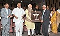 Narendra Modi presenting a memento to Mr. Vijay Shirke, during the inauguration of the Appasaheb Pawar Auditorium of Agricultural Development Trust, in Baramati, Maharashtra. The Governor of Maharashtra.jpg