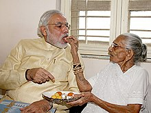 Modi being fed by his mother