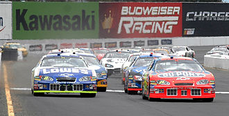Toyota/Save Mart 350 - Jeff Gordon and Jimmie Johnson leading the field at the start of the 2005 race