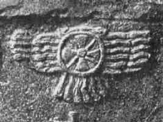Winged sun - Stele to Assurnasiripal II at Nimrud (9th century BC), detail showing the winged sun.