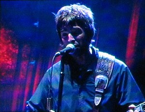 Noel Gallagher - Gallagher performing with Oasis at the Shoreline Amphitheatre on 11 September 2005
