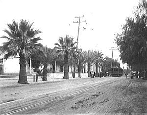 Mission San Gabriel Arcángel - A streetcar of the Pacific Electric Railway makes a stop at Mission San Gabriel Arcángel c. 1905.