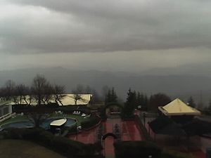 A rainy view of Murree Hills from Pearl Contin...