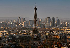 Paris, with the Eiffel Tower in the foreground and the skyscrapers of La Defense in the background