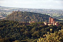 Peckforton Castle (right), with Beeston Castle in the background