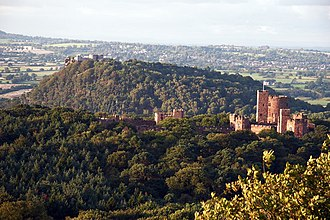Peckforton Castle - Peckforton Castle is in the right foreground and Beeston Castle is on the hill beyond