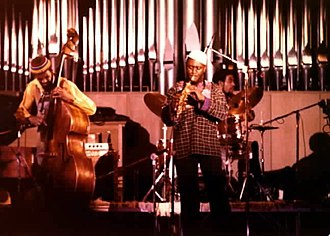 Jazz - Double bassist Reggie Workman, saxophone player Pharoah Sanders, and drummer Idris Muhammad performing in 1978