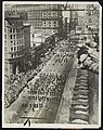 Photo shows general view of the Preparedness Day parade at San Francisco in 1916 looking down Mark Street toward the Ferry Building Tom Mooney and wife are shown in picture on roof top LCCN2016651585.jpg