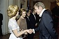 Photograph of Queen Alia of Jordan and First Lady Betty Ford Greeting Actor Charlton Heston in the Receiving Line at a State Dinner Honoring King Hussein of Jordan - NARA - 7840016.jpg