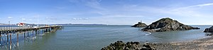Mumbles - Panoramic photograph of Mumbles Pier; the Lifeboat station and the lighthouse on the right