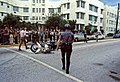 Police walks towards overturned motorcycle in front of the Collins Park Hotel during the 1972 Republican National Convention - Miami Beach, Florida.jpg