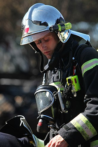 Firefighter's helmet - F1 helmet with back cover and side-mounted flashlight